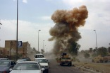 As Coalition Forces respond to a car bombing in South Baghdad, Iraq (IRQ), a second car bomb is detonated, targeting those responding to the initial incident. The attack, aimed at the Iraqi police force, resulted in 18 casualties, two of which were police officers, during Operation IRAQI FREEDOM.