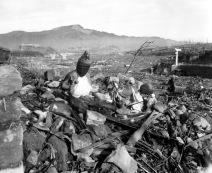 Battered religious figures stand watch on a hill above a tattered valley. Nagasaki, Japan. September 24, 1945. Cpl. Lynn P. Walker, Jr. (Marine Corps) NARA FILE #: 127-N-136176 WAR & CONFLICT BOOK #: 1241